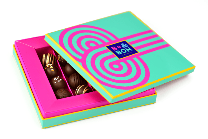 Bon Bon Packaging with False Wall and Accordion Tray Insert